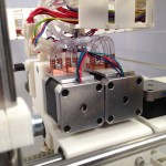 Dual extruders, back view - water cooled planetary geared stepper motors